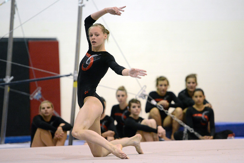 Loveland High School's Claire Hammen performs her floor exercise during a dual meet against Thompson Valley on Tuesday, Oct. 2, 2012 at LHS.