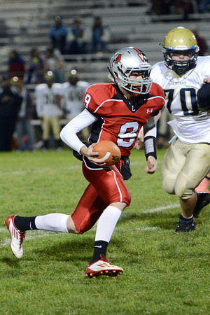 Loveland High School quarterback Mike Zwiegle runs with the ball in the first quarter of a game against Greeley West on Thursday, Oct. 4, 2012 at Patteson Stadium.