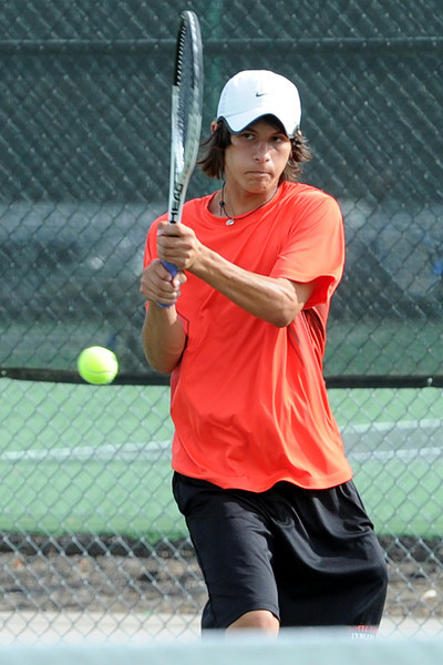 Loveland High School senior Joseph Diaz returns a shot during his match against Fossil Ridge's Lucas Martin on Tuesday, Sept. 25, 2012 at LHS.