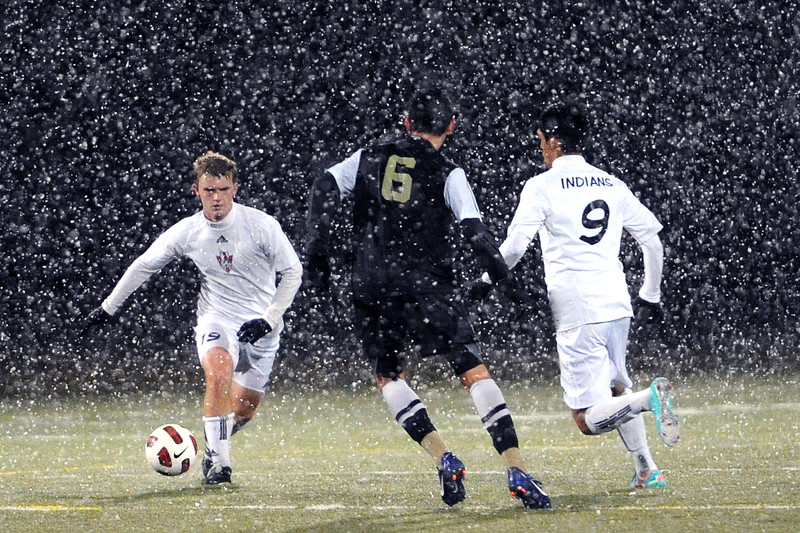 Loveland High School's Jayce Melby, left, and Cristian Buendia, right, work against Rock Canyon's Ben Bartlett during the first half of their match Wednesday, Oct. 24, 2012 at the Loveland Sports Park.