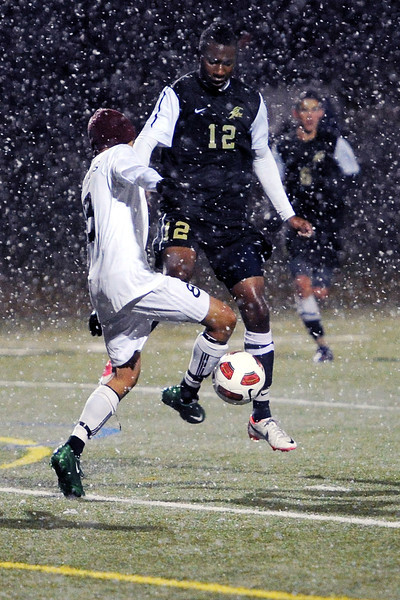 Loveland High School's Adrian Cordova, left, collides with Rock Canyon's Cameron Gill as they go after the ball in the first half of their match Wednesday, Oct. 24, 2012 at the Loveland Sports Park.