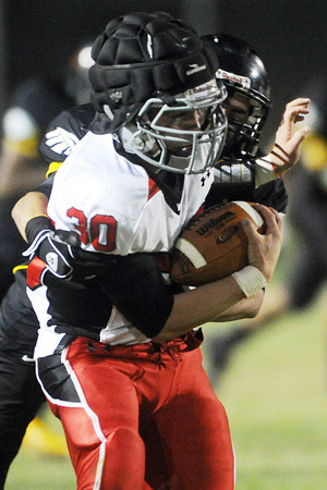 Loveland High School linebacker Jake Weinmaster (30) is pursued by Thompson Valley's Drew Meintzer after intercepting a pass in the first quarter of their game Friday, Oct. 19, 2012 at Patterson Stadium.