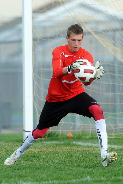 Loveland High School goalie Eli Rodgers makes a stop during a match against Fort Collins on Thursday, Sept 27, 2012 at the Mountain View soccer field.
