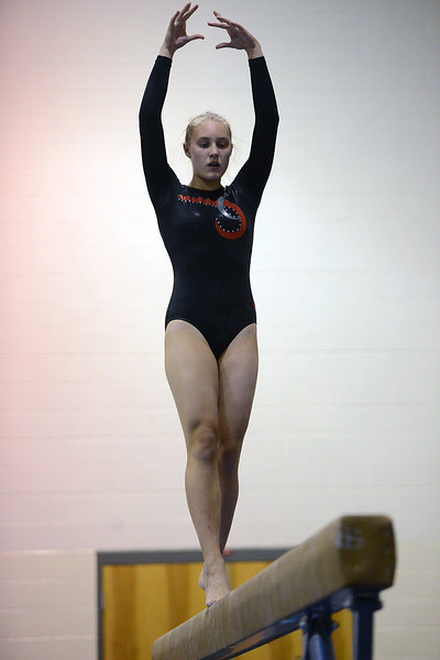 Loveland High School's Abigail Strand competes on the balance beam during a dual meet against Thompson Valley on Tuesday, Oct. 2, 2012 at LHS.