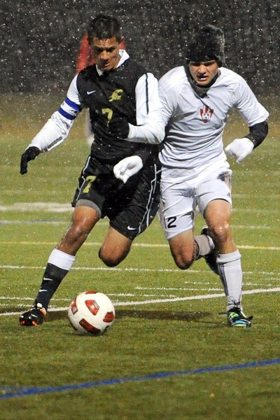 Loveland High School junior Nicholas Grindy, right, and Rock Canyon's Reese Werden battle for control of the ball during the first half of their match Wednesday, Oct. 24, 2012 at the Loveland Sports Park.