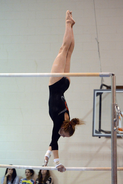 Loveland High School's Claire Hammen performs her routine on the uneven bars during a dual meet against Thompson Valley on Tuesday, Oct. 2, 2012 at LHS.