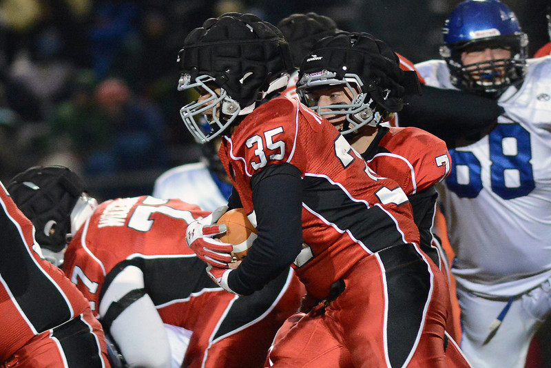 Loveland High School quarterback Graham weeks (7) fakes a handoff to running back Kris Garcia (35) during their game against Longmont on Friday, Oct. 26, 2012 at Patterson Stadium.