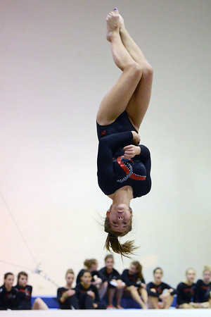 Loveland High School's Sharalyn Grulke does a flip as part of her floor exercise during a dual meet against Thompson Valley on Tuesday, Oct. 2, 2012 at LHS.
