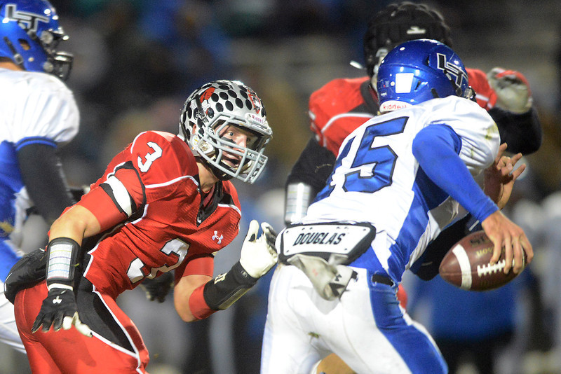 Loveland High School defensive back Greg Hecker (3) pursues Longmont quarterback Forrest Wetterstrom in the second quarter of their game on Friday, Oct. 26, 2012 at Patterson Stadium.