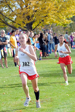 Loveland High School cross country teammates Kristina Ritschard, left, and Abby Stewart run down the final stretch toward the finish line during the Class 5A Region 4 Championships on Friday, Oct. 19, 2012 at North Lake Park.