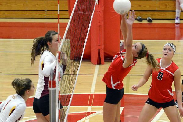 Loveland High School's Celine Packham, right, looks on while teammate Brooke Hansen returns a shot during a match against Rocky Mountain on Tuesday, Sept. 25, 2012 at LHS.