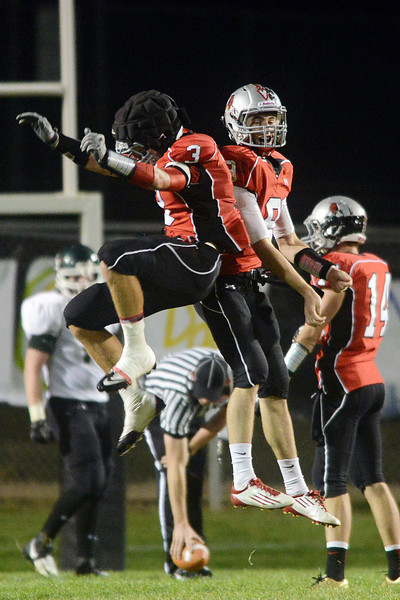 Loveland High School's Greg Hecker (3) and Mike Zweigle (9) celebrate after Zweigle's touchdown during their game against Niwot on Friday, Sept. 28, 2012 at Patterson Stadium.
