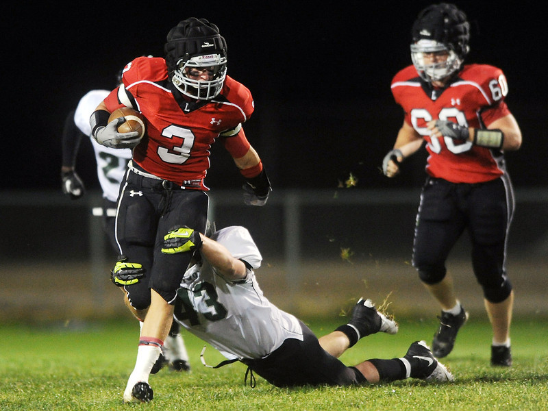 Loveland High School's Greg Hecker (3) is pursued by Niwot's Danny Caruso (43) on a punt return in the first quarter of their game on Friday, Sept. 28, 2012 at Patterson Stadium.