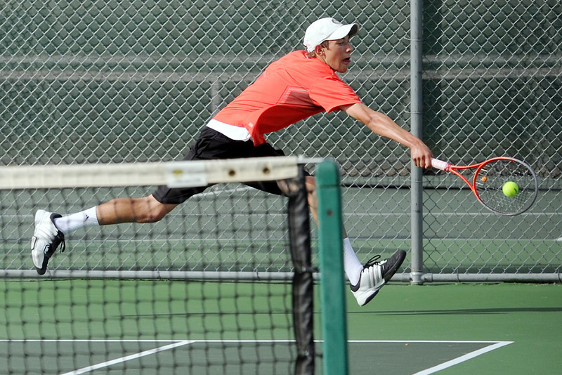 Loveland High School sophomore Garet Davis lunges for a backhand during his match Tuesday, Sept. 25, 2012 against Fossil Ridge's Tanner Trace at LHS.