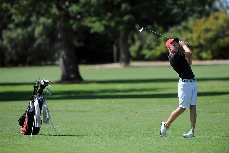 Loveland High School's Cole Bundy watches his approach shot on No. 1 during the Walt Clark Invitational on Sept. 5, 2012 at The Olde Course at Loveland.