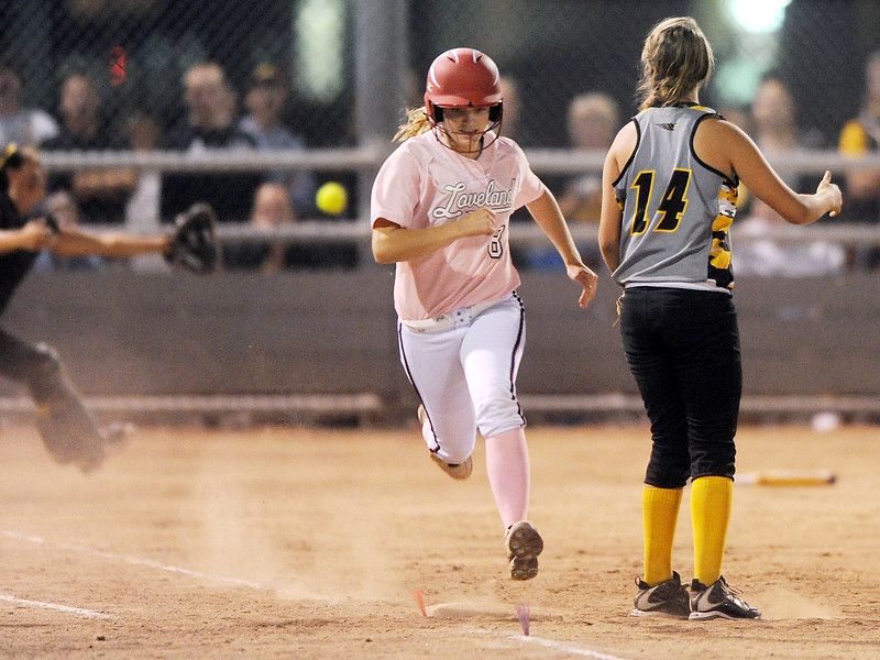 Loveland High School's Addie Coldiron (8) sprints to first base for a single as Thompson Valley's Allie Mason (14) looks on in the bottom of the fifth inning of their game on Friday, Sept. 21, 2012 at Centennial Park.