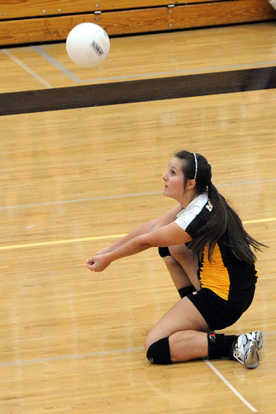 Thompson Valley High School junior Paige Daniels digs a ball during a match against Loveland on Friday, Aug. 31, 2012 at TVHS.