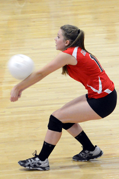 Loveland High School senior Talylor Mitchell bumps a serve during set two of a match against Rocky Mountain on Tuesday, Sept. 25, 2012 at LHS.