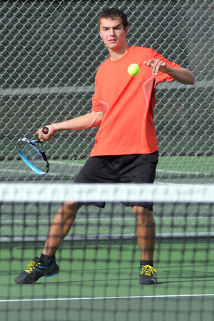 Loveland High School's Cory Winkelhake returns a shot during his match against Fossil Ridge's Max Weiner on Tuesday, Sept. 25, 2012 at LHS.