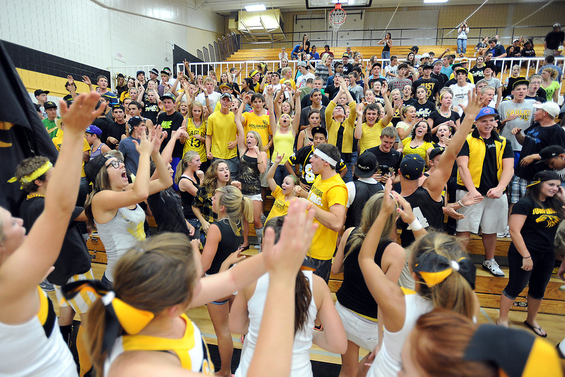 Thompson Valley High School cheerleaders lead the student section in a cheer after the volleyball team defeated Loveland in set two of their match Friday, Aug. 31, 2012 at TVHS.