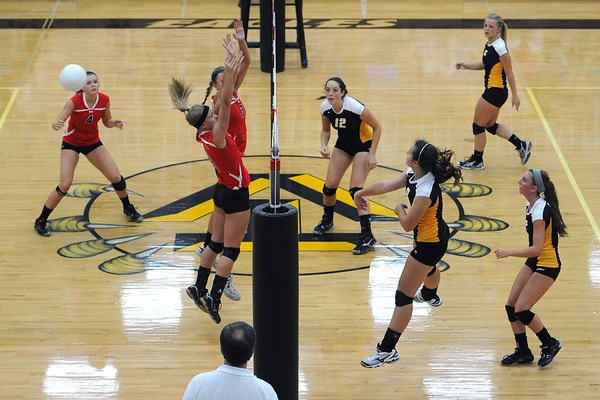 Loveland High School players, at left, go against Thompson Valley during a match Friday, Aug. 31, 2012 at TVHS.