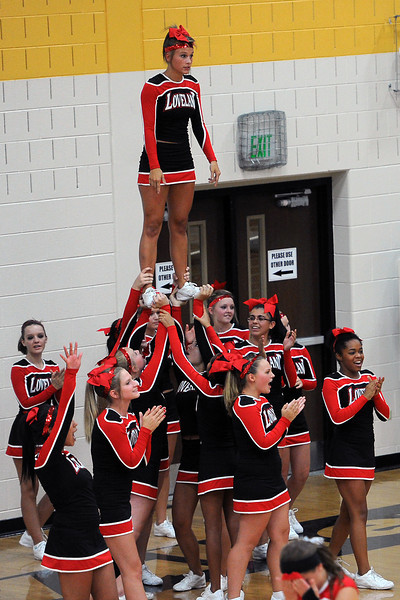Loveland High School cheerleaders perform a cheer during a volleyball match against Thompson Valley on Friday, Aug. 31, 2012 at TVHS.