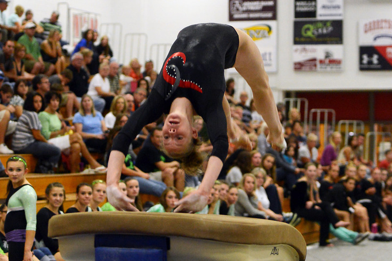 Loveland High School's Claire Hammen performs her vault routine during the Indian Invitational on Friday, Sept. 7, 2012 at LHS.