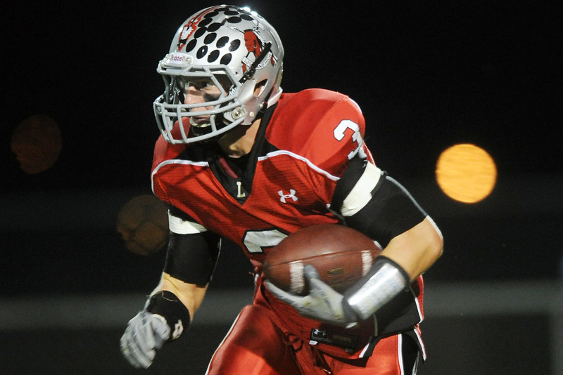 Loveland HIgh School running back Greg Hecker makes a carry in the second quarter of a game against Broomfield on Thursday, Sept. 13, 2012 at Patterson Stadium.