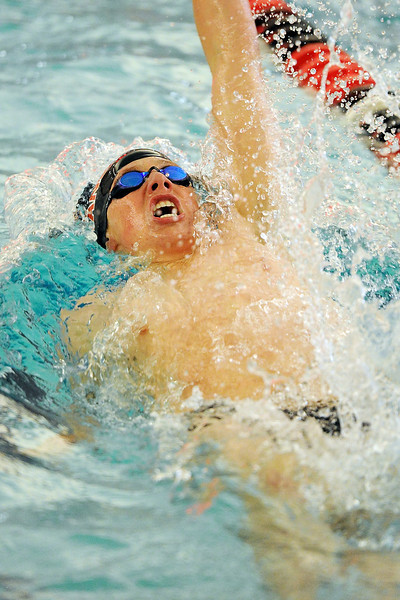 Loveland High School's Ryan Ball competes in the backstroke during a dual meet against Legacy on Thursday, April 26, 2012 at Loveland's pool.