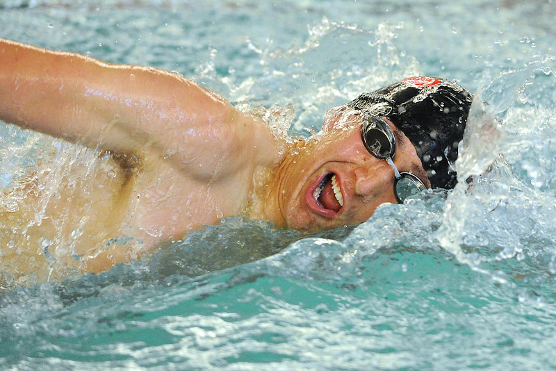 Loveland High School senior Travis Davis swims in the 100-yard freestyle during a dual meet against Legacy on Thursday, April 26, 2012 at Loveland.