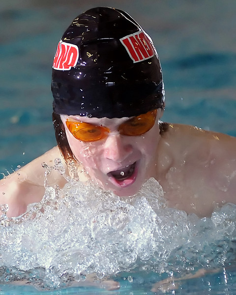 Loveland High School freshman Erik Trenary swims in the 100-yard breaststroke during a dual meet against Poudre on Thursday, April 29, 2010 at the Mountain View Aquatic Center.