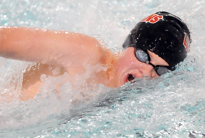 Loveland High School's Cooper Bowen swims a leg of the 200-yard freestyle relay during a dual meet Tuesday, April 6, 2010 against Thompson Valley at the Dick Hewson Aquatic Center.