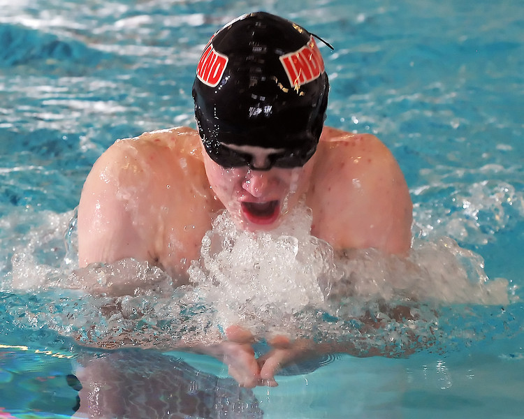 Loveland High School freshman Pat Jones swims in the 100-yard breaststroke during a dual meet against Poudre on Thursday, April 29, 2010 at the Mountain View Aquatic Center.