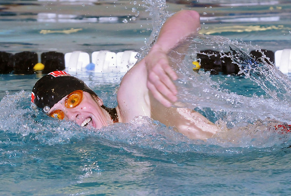 Loveland High School freshman Erik Trenary swims in the 500-yard freestyle during a dual meet against Poudre on Thursday, April 29, 2010 at the Mountain View Aquatic Center.