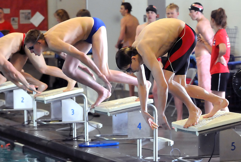 Loveland High School freshman NIck Hatanaka, right, at the start of the 50-yard freestyle during a dual meet against Poudre on Thursday, April 29, 2010 at the Mountain View Aquatic Center.