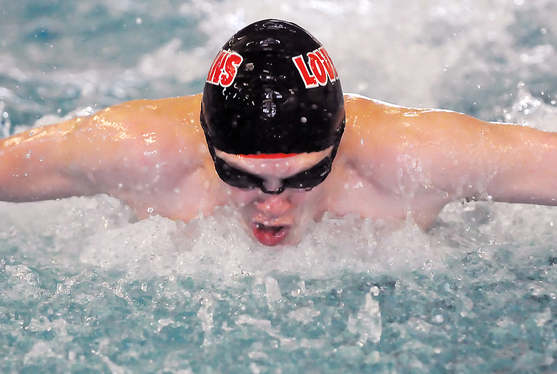 Loveland High School freshman Than McNally competes in the 100-yard butterfly during the Loveland City Meet on Tuesday, April 20, 2010 at the Moutain View Aquatic Center.