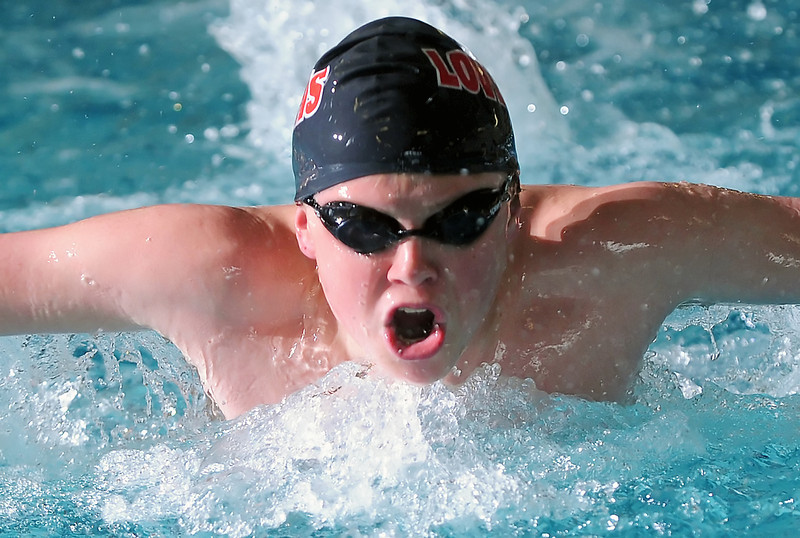 Loveland High School freshman Cooper Bowen swims in the 100-yard butterfly during a dual meet against Poudre on Thursday, April 29, 2010 at the Mountain View Aquatic Center.