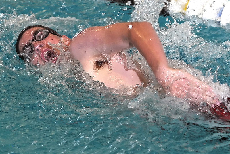 Loveland High School freshman Aidan Duggan swims in the 100-yard freestyle during a dual meet against Poudre on Thursday, April 29, 2010 at the Mountain View Aquatic Center.