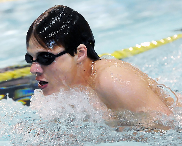 Loveland High School's Nick Hatanaka swims in the 100-yard breaststroke during a dual meet against Thompson Valley on Tuesday, April 6, 2010 at the Dick Hewson Aquatic Center.
