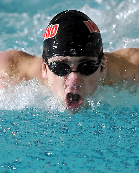 Loveland High School senior Eric Waite swims in the 100-yard butterfly during a dual meet against Poudre on Thursday, April 29, 2010 at the Mountain View Aquatic Center.