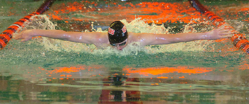 Loveland's Erik Trenary swims the 100 butterfly Thursday.