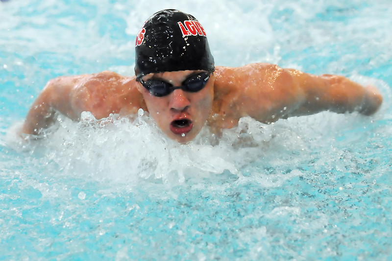 Loveland High School sophomore Nick Hatanaka swims in the consolation finals of the 100-yard butterfly during the Dick Rush Swim and Dive Invitational on Saturday at the Edora Pool Ice Center in Fort Collins.