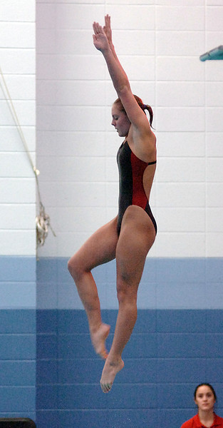 Michal Bower dives Saturday during the 5A State Swimming and Diving competition.