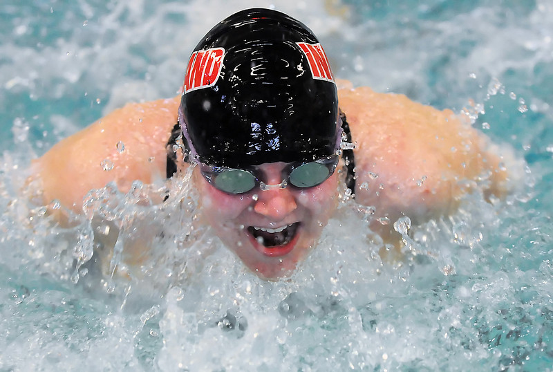Loveland High School sophomore Catherine Homan swims the butterfly portion of the 200-yard medley during the Front Range League Swimming and Diving Championships at the Mountain View Aquatic Center on Friday, Feb. 5, 2010.
