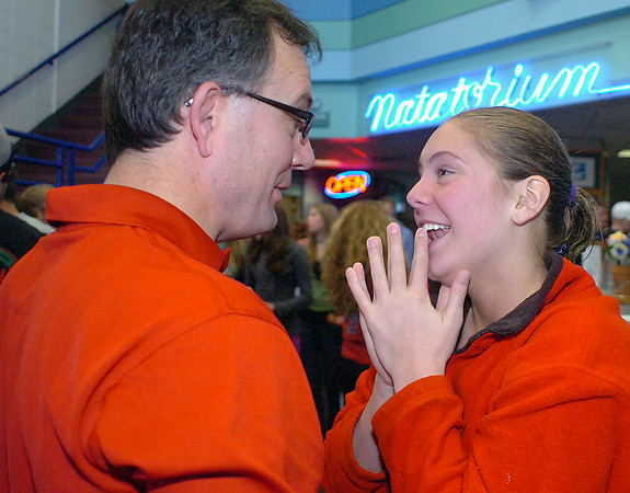Loveland High School's Michal Bower, 5A State Diving Champion, shares a moment with her dad Mark Bower after taking first place in the competition at Edora Pool and Ice Center in Fort Collins on Saturday.