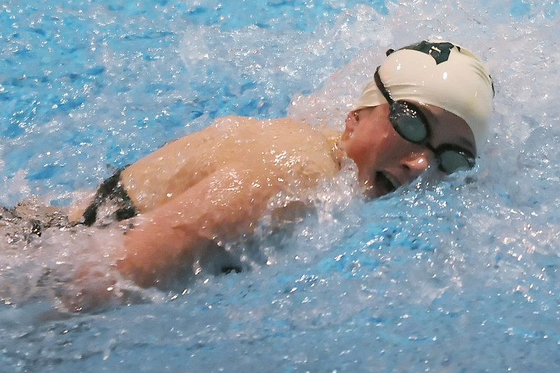 Fossil Ridge High School's Rhianna Williams swims in a heat of the 50-yard freestyle preliminaries Friday at Veterans Memorial Aquatic Center in Thornton during the 2011 Front Range League swim meet.