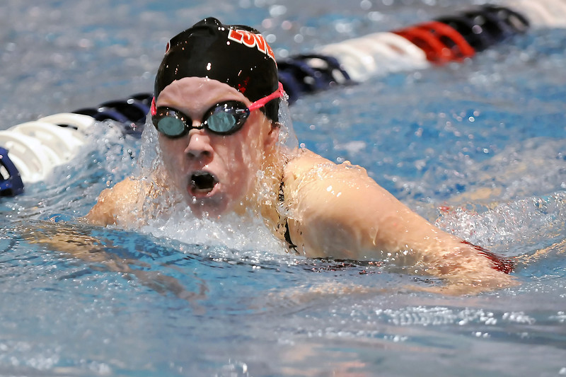 Loveland High School's Sydney Miller swims in a heat of the 200-yard individual medley during the 2011 Front Range League swim meet at Veterans Memorial Aquatic Center in Thornton on Friday.