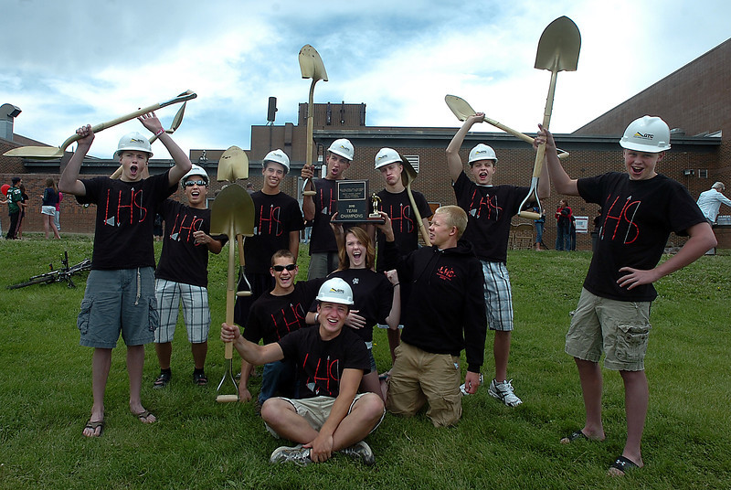 Members of the Loveland High School swim team pose for a photo celebrating the groundbreaking of their new swimming ppol Thursday at Loveland High School. From left on the bottom are Eric Waite, Mike Blomquist, Kinsey Helfrich, and Brandon Hatanaka. Top from left are Erik Trenary, Logan Peiffer, Dave Gauvin, Travis Davis, Pat Jones, Ethan McNally, and Cooper Bowen.