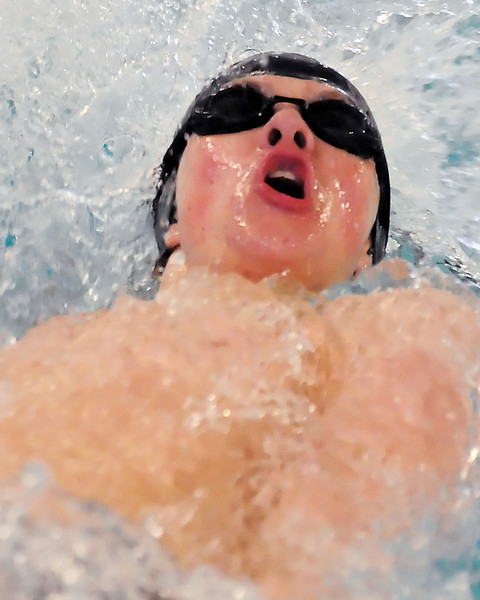 Loveland High School freshman Pat Jones swims the baqckstroke portion of the 200-yard medley relay during a dual meet against Rocky Mountain on Tuesday at the Mountain View Aquatic Center.