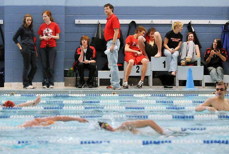 Loveland High Schoolers hang out on the side of the pool during warm-ups for the Dick Rush Invitational swim meet on Saturday, March 20, 2010 at the Edora Pool Ice Center in Fort Collins. Back from left are Ashley Streich, Megan Kellums, Erik Trenary, Tony Helfrich, Travis Davis, Eric Waite, Mandy Bowen, Kenzie Helfrich, and Cody Brown.